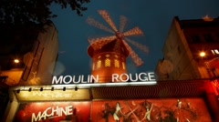 Moulin Rouge Cabaret night club in the Pigalle neighborhood, Paris France - stock footage