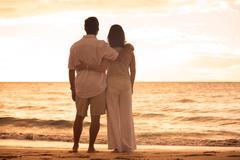 mature couple enjoying sunset - stock photo