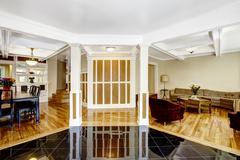 Luxury interior. foyer with black shiny tile floor, columns and coffered ceil Stock Photos