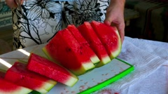 Man cuts the watermelon into slices Stock Footage