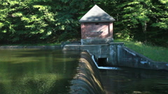 WATER DAM BY POND Stock Footage
