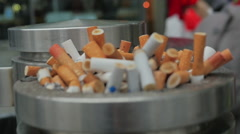 Cigarette Butts in Ashtray on the Street 2 Stock Footage