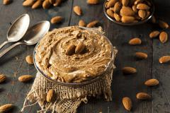 Raw organic almond butter Stock Photos