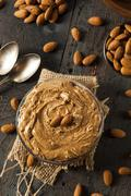 raw organic almond butter - stock photo