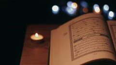 Arabic Book and candles. Shot with slider Stock Footage