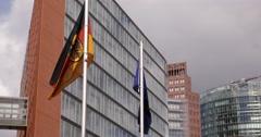 UHD 4K Potsdamer Platz German European Flags Office Building Apartments Complex Stock Footage