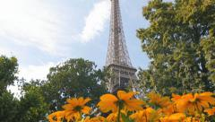 eiffel tower unusual view tilt behind flowers - stock footage