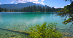 4K Pristine Cystal Clear Lake Water, Jasper Park Lodge, Banff Alberta Stock Footage