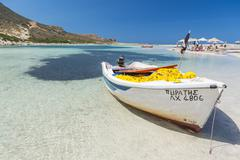 white boat in the lagoon of balos - stock photo