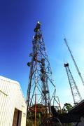 telecom tower and blue sky - stock photo