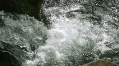 Waterfall falls into river in slow motion and bubbles of oxygen Stock Footage