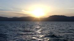 Seascape, Sunset, Sea Waves at Sunrise above Rocky Silhouette of Ko Samui Island Stock Footage