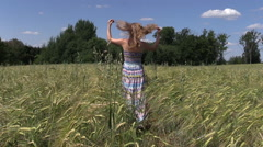 Pregnant woman walk barley plants in agricultural field Stock Footage