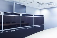Teleconferencing, video conference and telepresence screen display monitor in Stock Photos