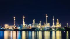 Stock Photo of oil refinery at twilight, business logistic concept