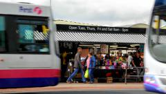 Busy bus traffic passing on Bolton market day Stock Footage