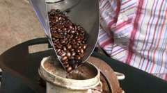Coffee beans being ground in Colombia Stock Footage