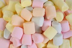 Small colored puffy marshmallows background Stock Photos
