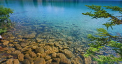 4K Alberta Canada, Rippling Lake Water, Beauiful Mountain Lodge Stock Footage