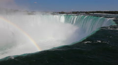 A rainbow at the crest of Niagara Falls - stock footage