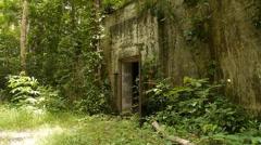 World War II abandoned jungle bunker arsenal 17 Stock Footage