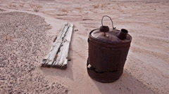 Abandoned Gas Can in Badlands Wilderness with Ghost Town Wood Stock Footage