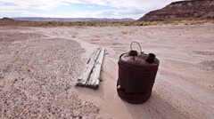 Abandoned Gas Can in Badlands Wilderness with Ghost Town Wood WIDE SHOT Stock Footage