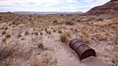 Abandoned 55 Gallon Drum in Badlands Wilderness Desolation and Drought Stock Footage