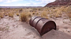 Abandoned 55 Gallon Drum in Badlands Wilderness Desolation Drought Sand Stock Footage