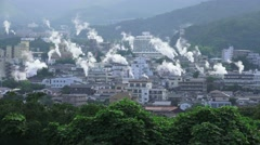 Steam Rises Over City Of Beppu Japan - Looks Like Smoke And Fire 01 4K Stock Footage