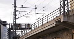 UltraHD 4K Regional Bahn Train Passing Railway Urban Area Level Crossings Brick Stock Footage