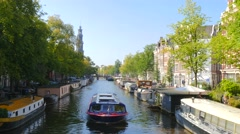 Amsterdam canal boat in canal - stock footage