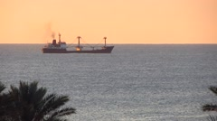 tanker ship at sea at sunrise - stock footage