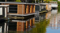 House boat in Amsterdam canal Stock Footage