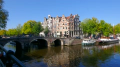 Amsterdam canalboat passing bridge Stock Footage