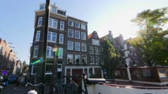 wide pan across Amsterdam canal to house boat - stock footage
