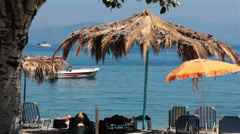 Parasols and sunbeds on the beach. Greece Stock Footage