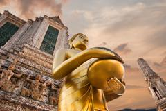 big statue of golden buddha in wat arun or temple of dawn. thai traditional b - stock photo