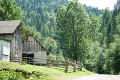 Rural landscape of carpathian mountains. small village with traditional woode Stock Photos