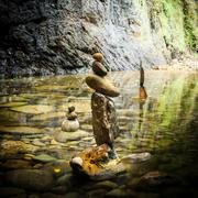 amazing tropical rain forest landscape with lake and balancing rocks tower fo - stock photo
