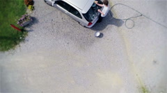 Top view of person cleaning back windshield on a car Stock Footage