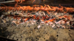 Bird roast on a spit in night market Thailand Koh Samui Stock Footage