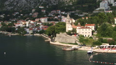 Kotor Montenigro aerial tracking shot of coastal land and town Stock Footage
