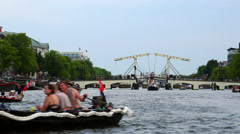 Famous Magere Brug bridge over Amstel river in Amsterdam Stock Footage