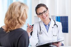 medical appointment in doctor's office - stock photo