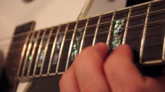 Man playing an electric guitar - stock footage