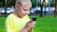 Boy with smatphone outdoor Stock Footage