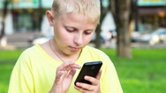 Stock Video Footage of boy with smatphone outdoor