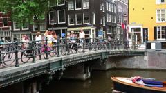 Stock Video Footage of Bicycles attached to a bridge in Amsterdam