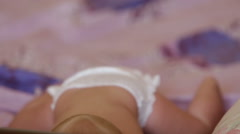 Child blond lying on bed Stock Footage